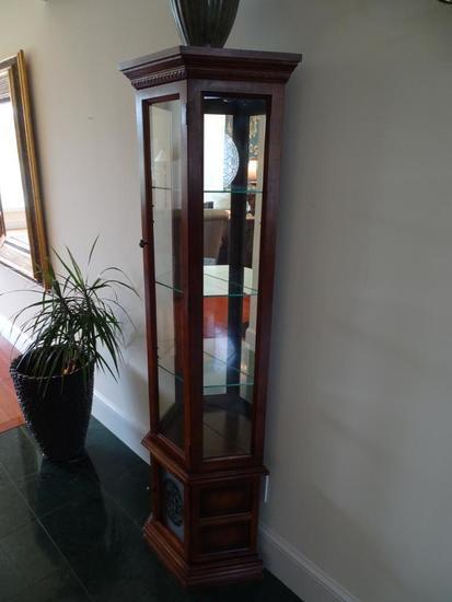 "Curio cabinet-inside lights-71"" tall x 11"" deep."