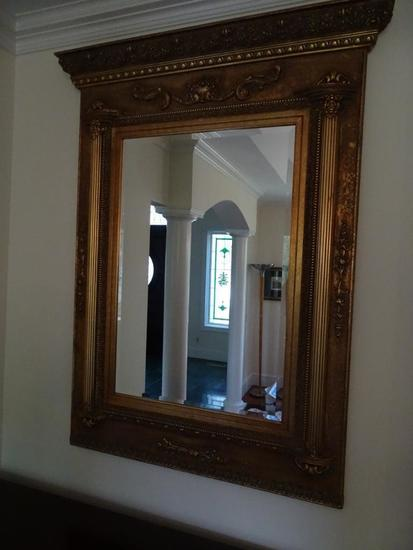 "Gold frame mirror-wood/plastic-56"" tall x 38"" wide."