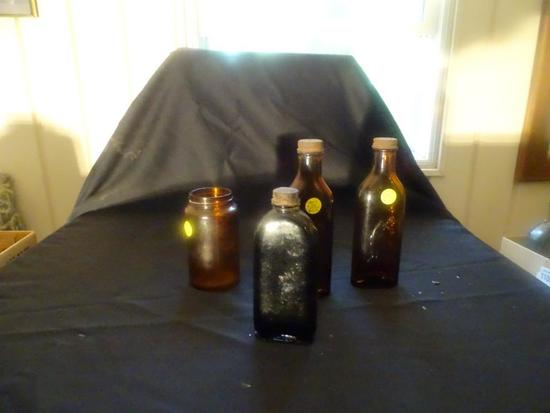 1800s Cod's Liver Oil bottles-2 with etched picture on front of fish/old man.
