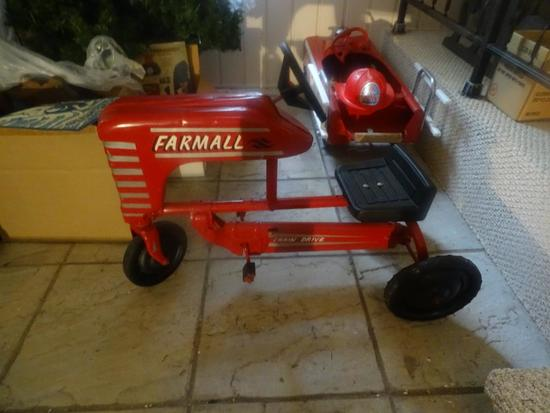 "Farmall tractor pedal car. ""Chain Drive"" Excellent condition.Heavy."