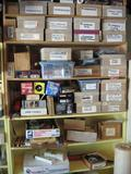 Several rows of items: Hole saws, Halogen Headlights, foot air pump, 7