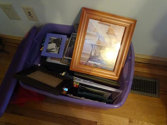 Tub of various size picture frames