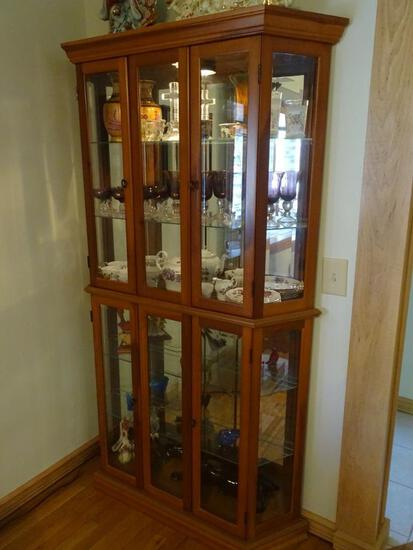 "Wood frame lighted curio cabinet. 76""H x 41"" L x 9.5""W"