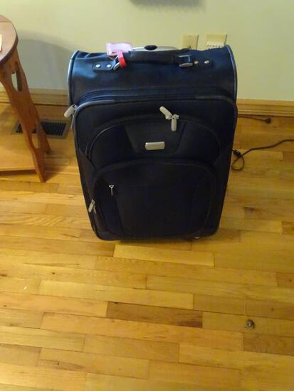 "Dockers Rolling (spinner) suitcase, 27"" tall."