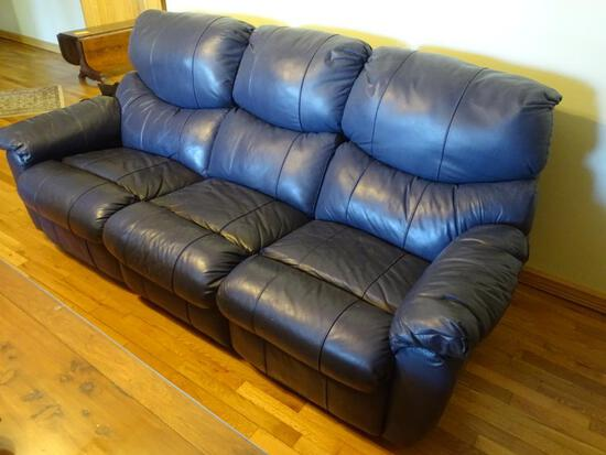 "Leather reclining sofa. 7'L x 3'W x 38"" H."