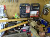 Table assorted tools-loppers, lawnmower blades, Delta ShopMaster, rechargeable batteries for drills