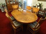 Oak Table and 6 chairs. 68
