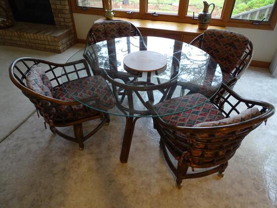 "Round glass top table w/4 chairs on casters-48"" D, sturdy wicker for chairs."