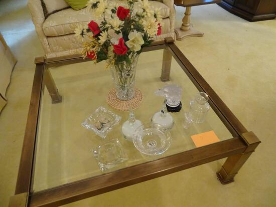 Items on table: Glass vase w/flowers, ash trays, Eagle head, bowl, etc