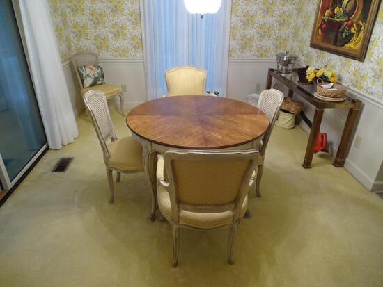French Provincial dining room set plus 6 chairs and three leaf extenders for table.