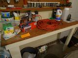 Everything on table-Ext. cord, trash bags, Nails.
