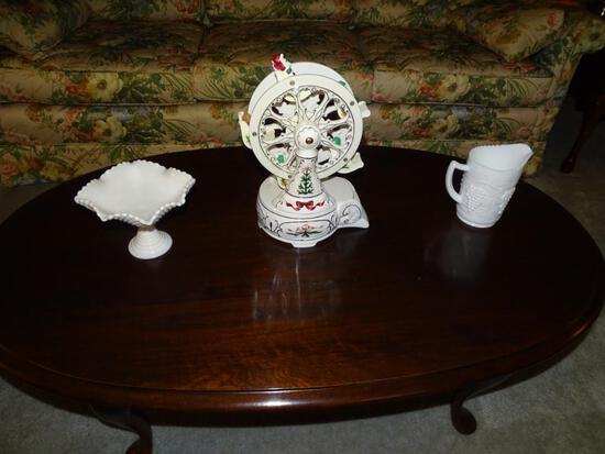 "Items on table-Milk glass and musical Christmas Ferris Wheel-plays ""O Christmas tree""."
