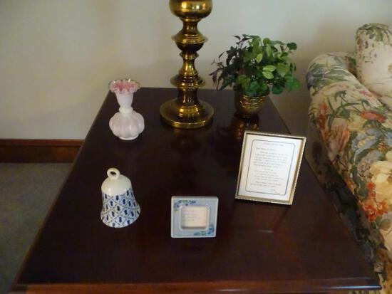 Items on table-bell, vase, picture frames, greenery