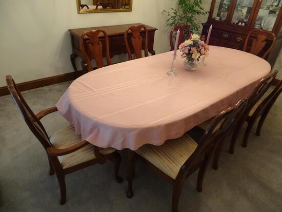 "Oval dining room table w/ 8 chairs, 44""W x 100"" L x 29""H-(table top needs to be refinished)."