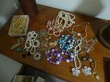 Costume Jewelry on table and in jewelry box