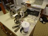 All items on counter: Electric frying pan, blender, electric can opener, grater, toaster oven, plus