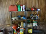 Items on shelves and floor: gas cans, fertilizer, chainsaw, blower, sprayer, freon tanks, hose, etc.