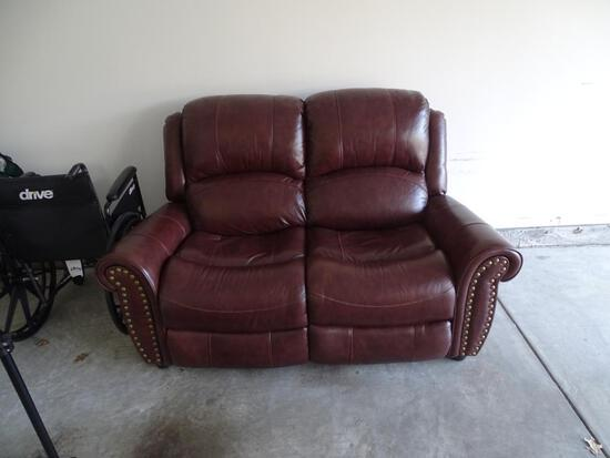 """Brown Leather Loveseat from Rooms to Go-62""""L x 33""""D x 45"""" H. Great condition!"""