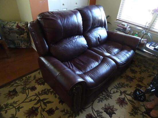 """Brown Leather Loveseat from Rooms to Go-62""""L x 33""""D x 45"""" H."""