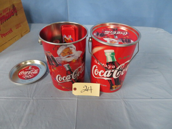 2 METAL COCA COLA CONTAINERS FILLED WITH COCA COLA ITEMS