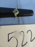 14 KT RING W/ WHAT LOOKS LIKE EMERALD STONE SURROUNDED BY 8 SMALL DIAMONDS - SIZE 5-1/2