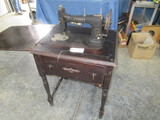 WHITE SEWING MACHINE IN CABINET