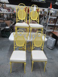 GLASS TOP YELLOW METAL PATIO TABLE W/ 4 CHAIRS - TABLE 50