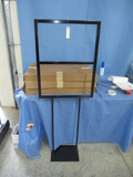 4- METAL SIGN STANDS- ONE IS ASSEMBLED, 3 NEW IN BOX