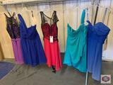 Beautiful dresses couture Miss Size 10 color purp/Blk. /size 12 color Cobalt / size 8 color fuchs /.