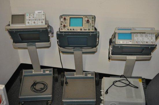 Oscilloscopes (4) and metal carts (3).