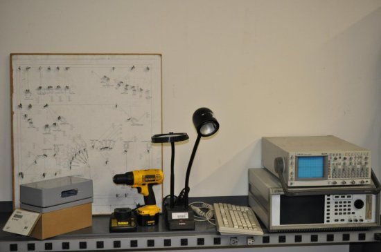 Oscilloscopes, power tool and lamp / contents of top shelf