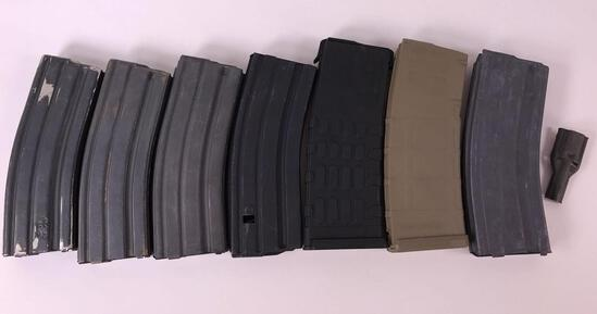 (7) AR15 30 Round Magazines and (1) Quick Loader