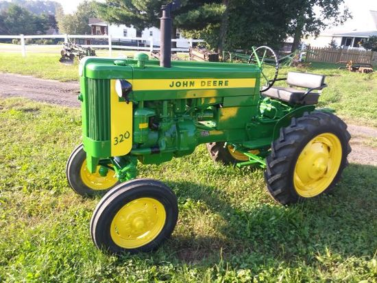1957 JD-320-S-#321338 - orig. Top link, new tires, repainted, only 1,836 built