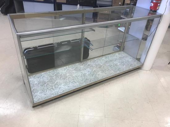 Glass Display Case, with shelves and brackets included. 72 inches long, 22 inches deep, 38 inch tall