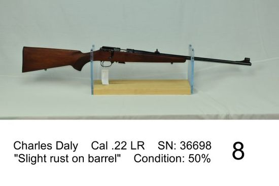 "Charles Daly    Cal .22 LR    SN: 36698    ""Slight rust on barrel""    Condition: 50%"