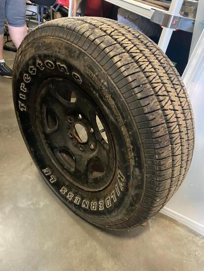 Firestone Wilderness P265 70r16 tire, with decent tread, on a 6 lug rim