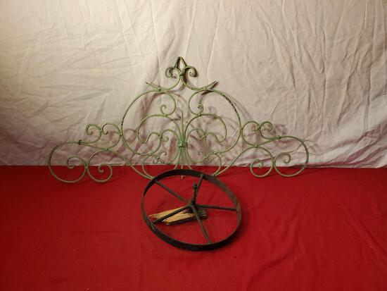 Metal wall embellishment, 35 x 16 inches, and vintage 8 inch metal wheel