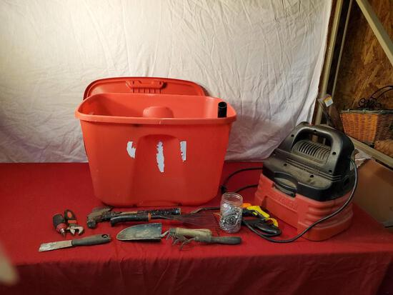 Plastic tote with lid, gardening tools, tools, and 2 gallon wet/dry vac