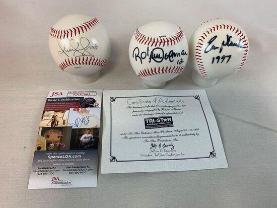 Omar Vizquel, Roberto Alomar, Eric Plunk signed baseballs in holders