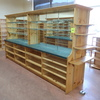 wooden shelving island, mirrored w/ glass shelves one side
