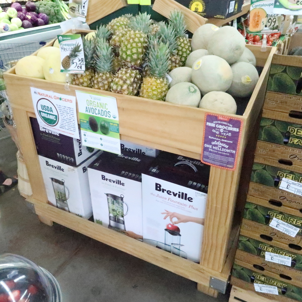 wooden produce merchandising fixture