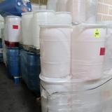 pallets of plastic barrels