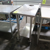 stainless table w/ undershelf on casters w/ dump hole