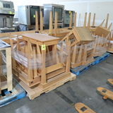 pallets of wooden tables