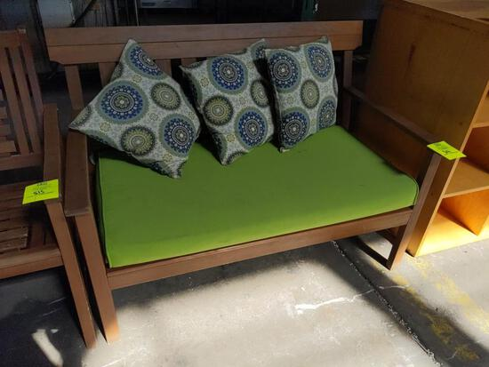 Wood bench with cushion and throw pillows