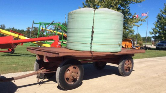 1500 gallon water tank and wagon with pump