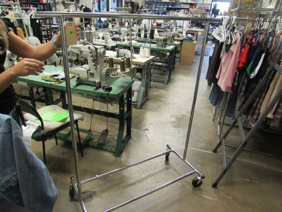 single chrome rolling clothing racks  48 inches.  Clothing shown in picture not included.