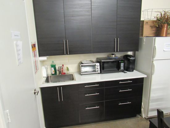 Kitchen Cabinet System with Stainless Sink 72 long by 25 inches Deep. This unit is in like new condi