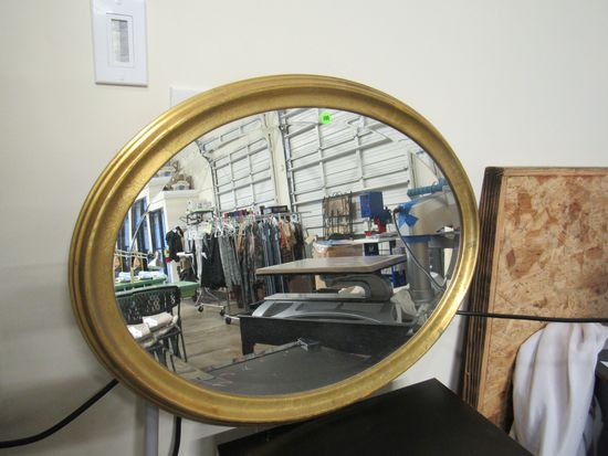 Gold Oval Mirror 31 by 23 beveled glass