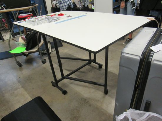 drop leaf cutting and layout table  60 inches by 36 inches
